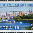 A stamp printed in Australia, is devoted to the Summer Olympics in Melbourne, shows Melbourne across Yarra River, circa 1956 — Stock Photo