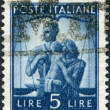 A stamp printed in Italy, shows the United Family and Scales, circa 1945 — Stock Photo