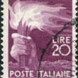 A stamp printed in Italy, shows a Torch, circa 1945 - Stock Photo
