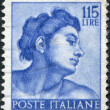 "Stock Photo: A stamp printed in Italy, shows Designs from Sistine Chapel by Michelangelo, Heads of various ""slaves"", circa 1961"