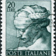 Постер, плакат: A stamp printed in Italy shows Designs from Sistine Chapel by Michelangelo Libyan Sybil circa 1961