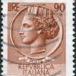 A stamp printed in Italy, is shown Italia Turrita after Syracusean Coin, circa 1968 - Stock Photo