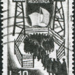 Stok fotoğraf: A stamp printed in Italy, devoted to 20th anniversary of the Italian resistance movement during World War II, shows the Italian Soldiers