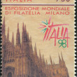 A stamp printed in Italy, is dedicated to the International Philatelic Exhibition, ITALIA - 98, shows the Cathedral of Milan, circa 1996 - Stock Photo