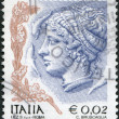 A stamp printed in Italy, is shown Profile of woman from Syracuse tetradrachm, circa 2004 - Stock Photo