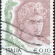 Royalty-Free Stock Photo: A stamp printed in Italy, shows the Head of terra cotta statue, 3rd century BC, circa 2004