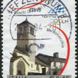 A stamp printed in Italy, is dedicated Winter Olympics, Turin, shows San Pietro Apostolo Church, Bardonecchia, circa 2004 — Stock Photo