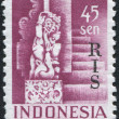 Stock Photo: Stamp printed in Indonesia, shows sculpture of god Shivfrom Temple at Bedjoening, Bali. Overprint RIS (Netherlands Indies)