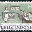 A stamp printed in the Indonesia, is dedicated to 4th Five Year Plan. Children in classroom, circa 1985 — Stock Photo