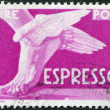 A stamp printed in Italy, shows a winged feet, circa 1951 — Stock Photo