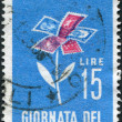 A stamp printed in Italy, shows a stylized flower of postage stamps, circa 1963 — Stock Photo