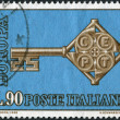Stock Photo: A stamp printed in Italy, shows a cross-shaped key, and CEPT emblem on the neck, circa 1968