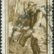 A stamp printed in Italy, shows the Woodcutter, the background Vajolet Towers (South Tyrol), circa 1950 - Stock Photo