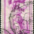 A stamp printed in Italy, is shown Woman carrying grapes, Castel del Monte (Apulia), circa 1950 — Stock Photo