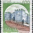 A stamp printed in Italy, shows the Castello dell'Imperatore, circa 1980 - Stock Photo