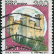 A stamp printed in Italy, shows the Rocca of Vignola, Modena, circa 1987 - Foto Stock