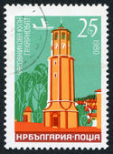 A stamp printed in the Bulgaria, shows a clock tower in the town of Karnobat, circa 1980 — Stock Photo
