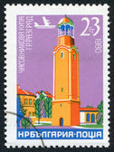 A stamp printed in the Bulgaria, shows a clock tower in the town of Razgrad, circa 1980 — Stock Photo