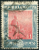 A stamp printed in the Argentina, depicts a farmer, a field of wheat and sun, circa 1912 — Stock Photo
