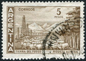 A stamp printed in the Argentina, shows the Tierra del Fuego Province and flock of sheep, circa 1959 — Stock Photo