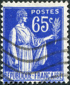 A stamp printed in France, shows an allegory of Peace with Olive Branch, circa 1937 — Stock Photo