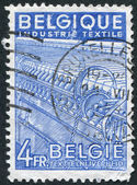 A stamp printed in Belgium, is dedicated to Textile Industry, circa 1948 — Stock Photo
