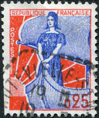 A stamp printed in France, depicts Marianne on a sailboat, circa 1960 — Stock Photo