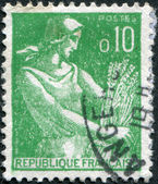 A stamp printed in France, shows a Farm Woman, circa 1960 — Stock Photo