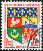 A stamp printed in France, depicts Arms of Oran (Algeria), circa 1960 — Foto de Stock