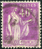 A stamp printed in France, shows an allegory of Peace with Olive Branch, circa 1933 — Stock Photo