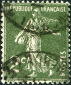 A stamp printed in France, depicts a sower, circa 1933 — Stock Photo