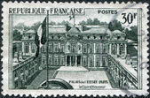 A stamp printed in France, shows the Elysee Palace (Presidential Palace), circa 1959 — Stock Photo