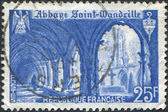 A stamp printed in France, shows the Cloister of St. Wandrille Abbey, circa 1949 — Stock Photo