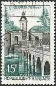 A stamp printed in France, shows the Le Quesnoy, castle and bridge, circa 1957 — Stock Photo