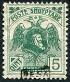 A stamp printed in the Albania (Shqiperia), depicts an eagle bicapital and ruler of Albania, George Kastrioti Skanderbeg, (overprint BESA) — Stock Photo