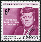 A stamp printed in the Democratic Republic of the Congo, is dedicated to the anniversary of the death of U.S. President John Kennedy, circa 1964 — Stock Photo