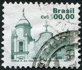 Postage stamps printed in Brazil, shows a Church of our Lady of Sorrow, Campanha, circa 1986 — Stock Photo