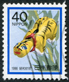 A stamp printed in Japan, depicts a tiger in papier-mache, Year of the Tiger, circa 1985 — Stock Photo
