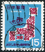 A stamp printed in Japan, is devoted to input postal code, a map of Japan from the figures, circa 1968 — Stock Photo