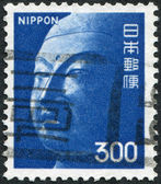 A stamp printed in Japan, depicts the head of the Buddha, the Temple Yamada, Asuka, circa 1974 — Stock Photo
