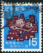 A stamp printed in Japan, is devoted to second anniversary of the entry postal codes, shows a postman and in their homes, circa 1970 — Stock Photo