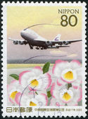 A stamp printed in Japan, is dedicated to the discovery of the international airport of Chubu, prefecture Aichi, shows a Boeing 747-400 — Stock Photo