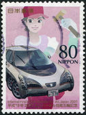 A stamp printed in Japan, dedicated to the International Skills Festival, Shizuoka, shows a teenager with a hammer and wood prototype car Ellica — Stock Photo