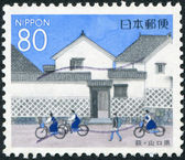 A stamp printed in Japan, Prefecture Yamaguchi, shows schoolchildren before Kikuya-family house, Hagi, circa 1999 — Stock Photo