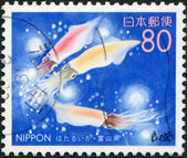 A stamp printed in Japan, Prefecture Toyama, shows Sparkling Enope Squid (Watasenia scintillans), circa 1999 — Stock Photo