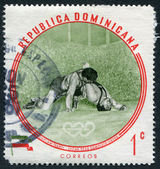 A stamp printed in the Dominican Republic, the Olympic champion Sholam Takhti, Iran, Lightweight Wrestling, circa 1960 — Foto de Stock