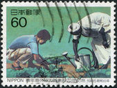 A stamp printed in Japan, dedicated to 20th anniversary of the Japanese Overseas Cooperation Volunteers, circa 1985 — Stock Photo