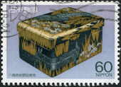 A stamp printed in Japan, shows a gilded stone inkwell, circa 1987 — Stock Photo