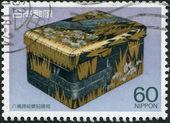 Eine briefmarke gedruckt in japan zeigt einen vergoldeten stein tintenfass, ca. 1987 — Stockfoto