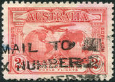 """A stamp printed in Australia, is dedicated to Trans-oceanic flights of Sir Charles Edward Kingsford-Smith, depicts """"Southern Cross"""" — Stock Photo"""